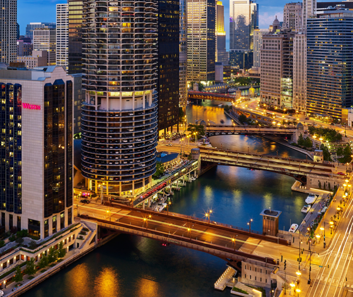 Image of the chicago river,  the exterior of the hotel and all adjacent buildings.